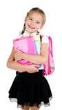 Porträt des lächelnden Schulmädchens mit Rucksack Lizenzfreie Stockbilder