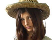 Porträt des Mädchens in einem Strohhut Stockfotos