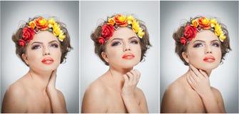 Porträt des schönen Mädchens im Studio mit den gelben und roten Rosen in ihrem Haar und in nackten Schultern Sexy junge Frau Lizenzfreies Stockfoto