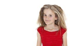 Porträt des Schulmädchens in der roten Ausstattung über weißem Hintergrund Lizenzfreies Stockbild