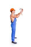 Porträt des sexy Mechanikers mit einem Hammer Lizenzfreie Stockbilder