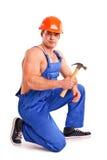 Porträt des sexy Mechanikers mit einem Hammer Lizenzfreie Stockfotos