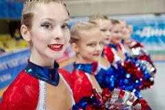 Porträt des Teilnehmers des Cheerleadermädchenteams Stockfotografie