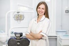 Porträt einer Ärztin in einem weißen Mantel Stockbild