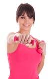 Porträt einer Eignungsfrau, die mit freien Gewichten ausarbeitet Lizenzfreies Stockfoto