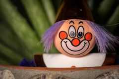Porträt einer Figürchens eines Clowns mit einem lächelnden Gesicht Lizenzfreie Stockbilder