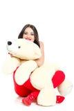 Porträt einer Frau mit einem Teddybären. Lizenzfreie Stockfotos