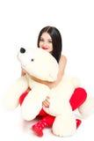 Porträt einer Frau mit einem Teddybären. Stockfotos