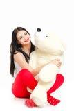Porträt einer Frau mit einem Teddybären. Lizenzfreies Stockfoto