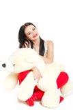 Porträt einer Frau mit einem Teddybären. Lizenzfreies Stockbild