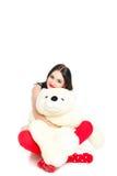 Porträt einer Frau mit einem Teddybären. Lizenzfreie Stockfotografie