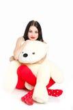 Porträt einer Frau mit einem Teddybären. Stockbild