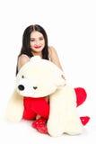 Porträt einer Frau mit einem Teddybären. Lizenzfreie Stockbilder