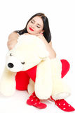 Porträt einer Frau mit einem Teddybären. Stockfotografie