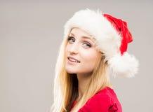 Porträt einer glücklichen Jugendlichen in einem Weihnachtshut stockfoto