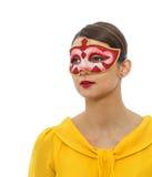 Porträt einer jungen Frau mit einer Maske Lizenzfreie Stockbilder
