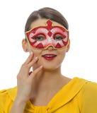 Porträt einer jungen Frau mit einer Maske Stockfotos