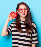 Porträt einer jungen Frau mit Uhr Stockbild