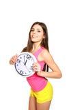 Porträt einer jungen Frau, eine Zeit für Sport auf weißem Hintergrund Stockfoto