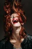 Porträt einer Rothaarigefrau Stockfotos