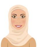 Moslemische Frau, die ein Hijab trägt Lizenzfreie Stockfotos