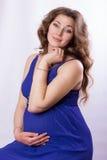 Porträt einer schönen schwangeren Frau Lizenzfreies Stockfoto