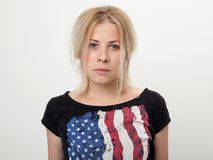 Porträt einer schönen und traurigen Blondine Stockfotos