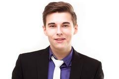Porträt eines attraktiven jungen lächelnden Geschäftsmannes Stockfotos