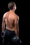 Porträt eines Bodybuilders mit Dummkopfansicht von der Rückseite Stockbild