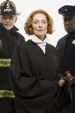 Porträt eines Feuerwehrmanns ein Richter und ein Polizeibeamte stockfotografie
