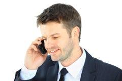 Porträt eines Geschäftsmannes mit dem Telefon lokalisiert Stockfotos