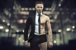 Porträt eines halben Geschäftsmannes des halben Athleten Stockfotos