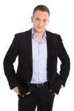 Porträt eines jungen blonden Geschäftsmannes in der Klage mit Sommersprossen lizenzfreies stockbild