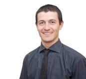 Porträt eines jungen Geschäftsmannlächelns Stockbilder