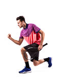 Porträt eines jungen männlichen Tennisspielers, der seinen Erfolg feiert stockbild