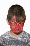 Porträt eines Jungen mit gemaltem Gesicht Stockfoto