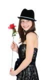 Porträt eines jungen und schönen Mädchens mit der Rose getrennt auf dem weißen Hintergrund stockfotografie