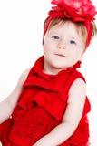 Porträt eines kleinen Mädchens auf einem weißen Hintergrund Lizenzfreie Stockbilder