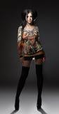 Porträt eines Mädchens in den Strümpfen und im Kleid lizenzfreies stockfoto