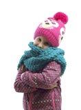 Porträt eines Mädchens in einer Kappe und in einem Schal stockbild