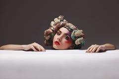 Porträt eines Mädchens mit einem ungewöhnlichen Make-up Lizenzfreie Stockbilder