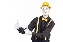 Porträt eines Mannes, ein Künstler, eine Pantomime Shows etwas, Isolator Lizenzfreies Stockfoto