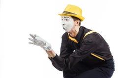 Porträt eines Mannes, ein Künstler, eine Pantomime Shows etwas, Isolator Lizenzfreie Stockbilder