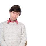 Porträt eines Mannes in einer Strickjacke mit einem dummen Blick auf seinem Gesicht Stockfotos