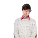Porträt eines Mannes in einer Strickjacke mit einem dummen Blick auf seinem Gesicht Lizenzfreie Stockbilder