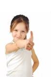 Porträt eines Mädchens, das die Daumen oben lokalisiert zeigt Lizenzfreie Stockfotos