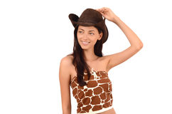 Porträt eines sexy amerikanischen Cowgirls mit dem Hut, der weg schaut. Lizenzfreie Stockbilder