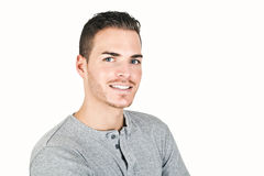 Porträt eines sportiven jungen Mannes lokalisiert auf Weiß Lizenzfreie Stockfotografie