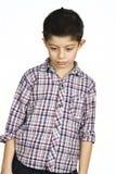 Porträt eines traurigen Jungen Stockfotos