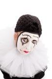 Porträt eines traurigen schauenden weiblichen Clowns Stockfotografie